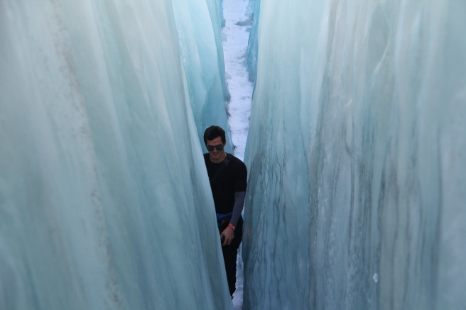 Elliot squeezing through the biggest crevasse